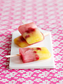 Homemade fruit ice lollies on a stick