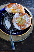 Ausgezogene (Bavarian-style doughnuts) dusted with icing sugar