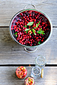 Cornelian cherries in a colander