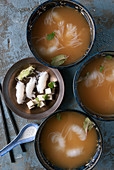 Bowls of miso soup with noodles and tofu