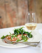 Fried Salmon with Bocconcini, fresh herbs and sour cream dressing, white wine in background