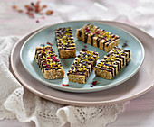 Vegan amaranth and almond bars with chocolate, dried flowers, pistachios and hemp seeds