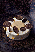 Ile Flottante ('floating island' dessert) garnished with truffle slices and gold leaf