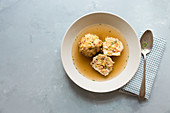Broth with bacon dumplings