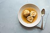 Broth with bacon dumplings