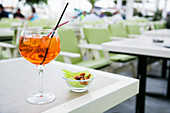 Aperol Spritz cocktail served in an open bar