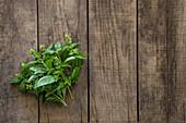 Italian Basil on Wood Surface