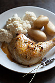 Chicken leg with lavender flowers, cauliflower and potatoes