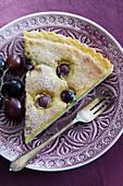 A piece of grape tart