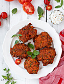 Tomato fritters with sour cream