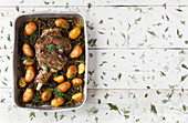 Roast leg of lamb with fennel and potatoes