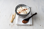 Yoghurt with pear skins and cocoa powder