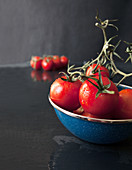 Freshly Washed Vine Ripened Tomatoes in a Blue Enamel Bowl