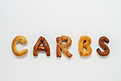 Carbs spelled out with bread basket goodies