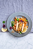 Quinoa salad with chickpeas and tempeh
