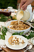 Pear pie with nuts and vanilla sauce