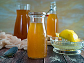Weight loss drink with ginger, apple vinegar, syrup and lemon
