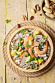 Rice salad with prawns, peas, pineapple and coconut shavings