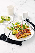 Fennel and chilli-crusted salmon with avocado and orange salad