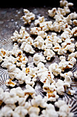 popcorn sprinkled with sea salt, on an antique textured baking sheet
