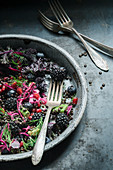 A lentil, blackberry, red cabbage and dill