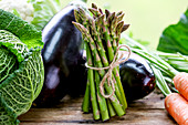 A vegetable still life with green asparagus