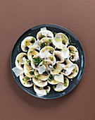 Mushroom carpaccio with Parmesan cheese