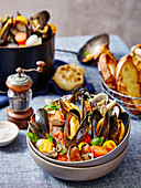 Mussels in white wine with cherry tomatoes and garlic bread