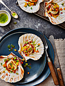 Scallops with diced peppers, tomato chutney and basil oil