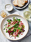 Winter duck salad with bread and white wine