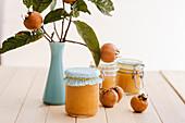 Jars of medlar jam and fresh medlars