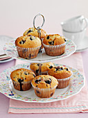 Berry muffins on a cake stand