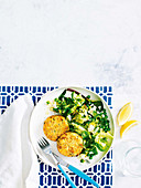 Salmon and potato patties with herbed pea salad