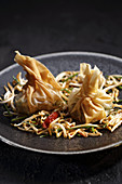 Dim sum on a bed of beansprouts (China)