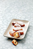 Homemade deep-fried pastries with icing sugar