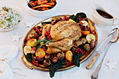 Winter roast chicken with fruit and vegetables