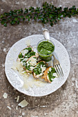 Baked potatoes with pesto and Parmesan cheese
