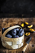 Plums in wooden basket