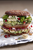 Veggie burger with cauliflower and pomegranate seeds