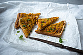 Toast topped with vegan chickpea curry spread