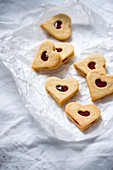 Vegan shortbread jam biscuits filled with strawberry fruit spread