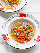 Chickpea soup with zucchini, carrots, chili, cumin and tomatoes