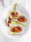 Mediterranean style fennel filled with olives, pine nuts and peppers