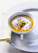 Sweet potato soup with carrots and lettuce flowers