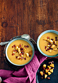 Pumpkin and apple cider soup with apple and bacon croutons