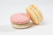 Two macarons against a white background (close up)