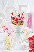 A bubble waffle with candy canes, foam strawberries and meringues