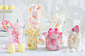 Pink and white sweets in jars