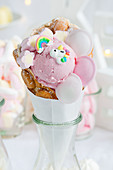 A bubble waffle with strawberry ice cream and unicorn decorations