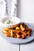 Potato wedges with thyme and dip
